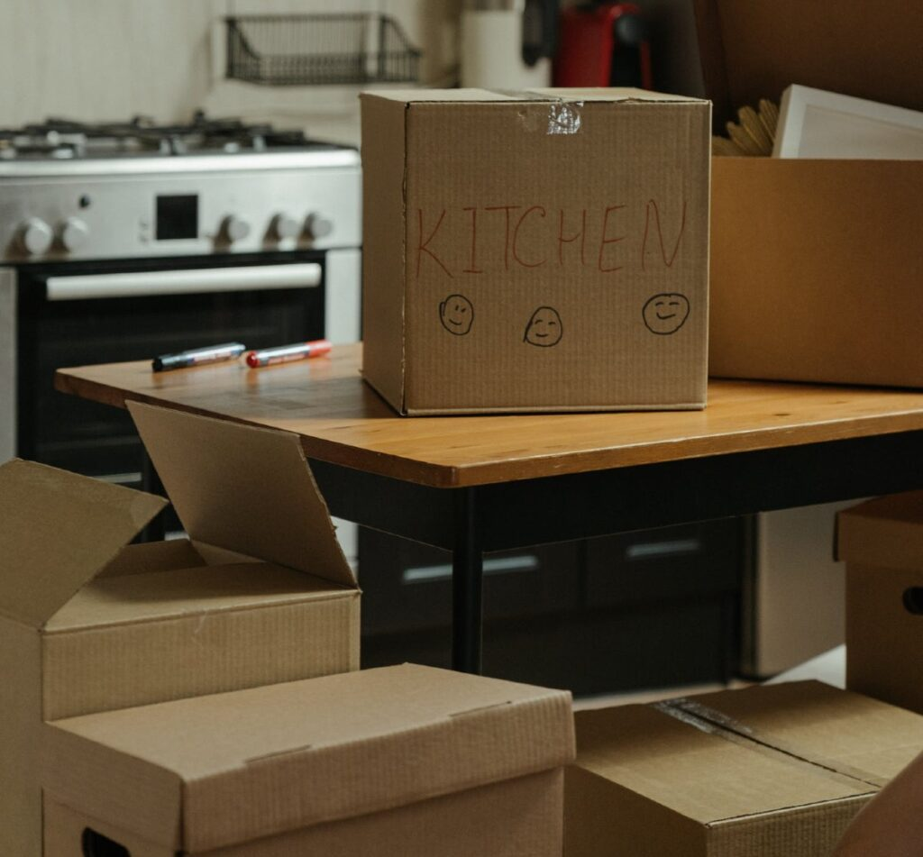 Box labeled kitchen on a kitchen counter