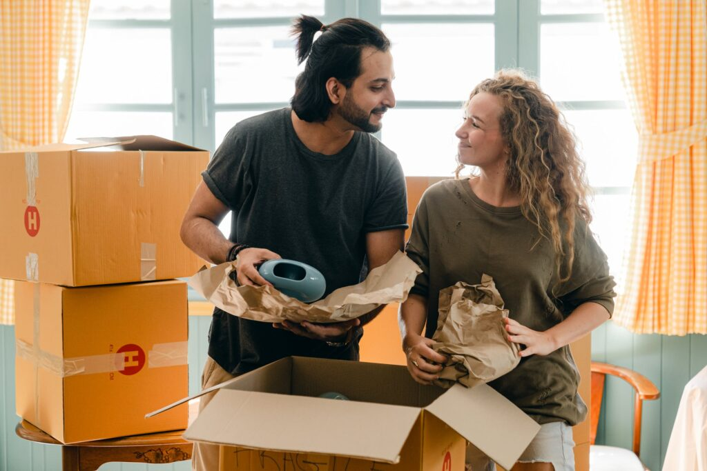 Couple packing delicate items for moving